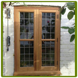 Casement Windows in Oak, with leaded double glazing.